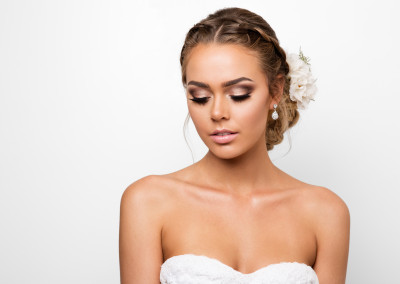 beautiful blonde bride with braided upstyle and glamourous pink and brown eye makeup