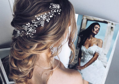 beautiful wedding updo on long braided hair with ulyana aster diamonte accessory on blonde hair