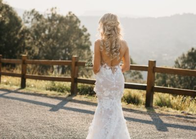 Blonde bride gold coast in beautiful white gown at summergrove estate with hair styling by Rachel Pivetta wedding hair stylist