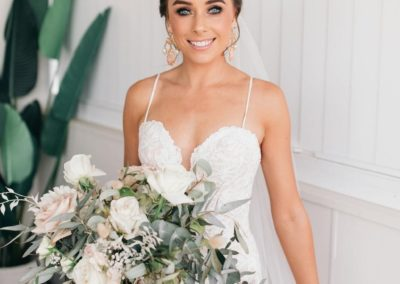 brunette-bride-hair-up-white-wedding-dress-flowers