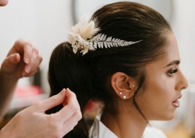 wedding-hair-for-bride-waves-ponytail-with-white-dried-hair-flowers