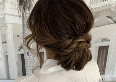 Bridal Upstyle Brunette Twised knotted bun with soft face framing pieces